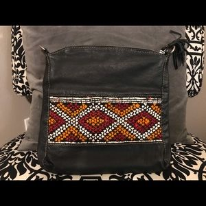 Intrinsic Flair black leather/woven crossbody bag